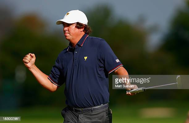 Jason Dufner of the U.S. Team makes birdie on the ninth hole during the Day One Four-Ball Matches at the Muirfield Village Golf Club on October 3,...