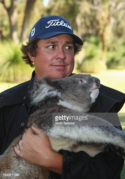 Jason Dufner of the USA handles a Koala after completing his first round during day one of the Perth International at Lake Karrinyup Country Club on...