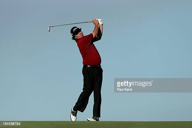 Jason Dufner of the USA plays his approach shot on the 18th hole during round three of the Perth International at Lake Karrinyup Country Club on...