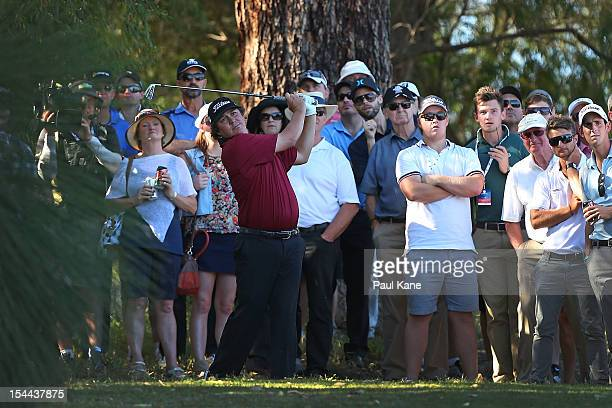 Jason Dufner of the USA plays out of the rough on the 12th hole during round three of the Perth International at Lake Karrinyup Country Club on...