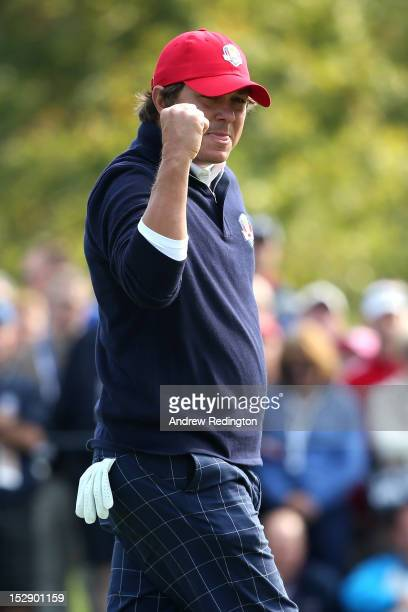Jason Dufner of the USA reacts to a birdie putt on the tenth green during the Morning Foursome Matches for The 39th Ryder Cup at Medinah Country Club...