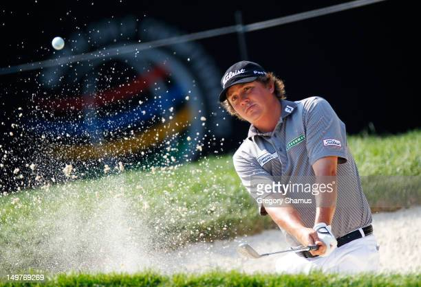 Jason Dufner plays a shot from a sand trap on the 16th hole during the second round of the World Golf ChampionshipsBridgestone Invitational at...