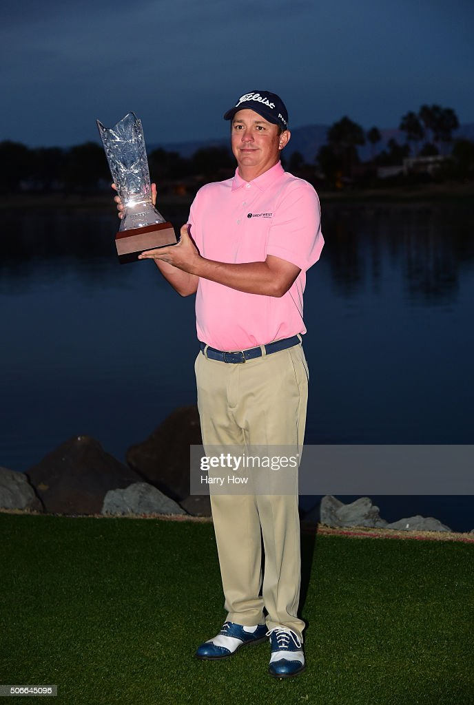 Jason Dufner poses with the trophy after winning the CareerBuilder Challenge In Partnership With The Clinton Foundation at the TPC Stadium course at PGA West on January 24, 2016 in La Quinta, California.