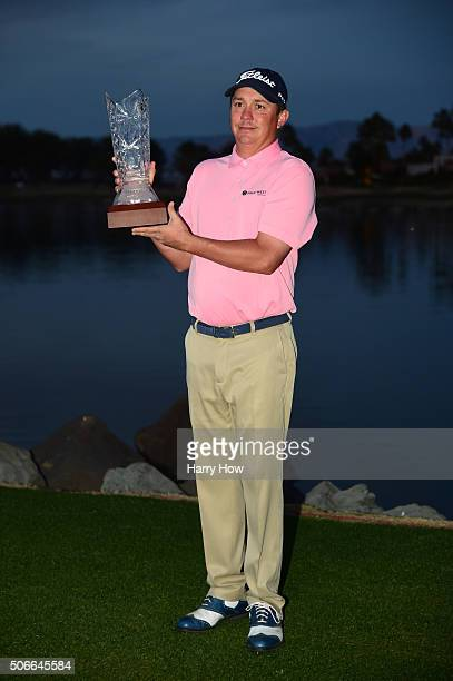 Jason Dufner poses with the trophy after winning the CareerBuilder Challenge In Partnership With The Clinton Foundation at the TPC Stadium course at...