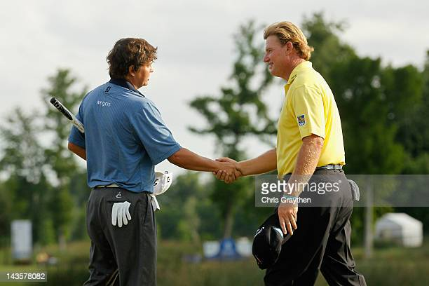 Jason Dufner shakes hands with Ernie Els of South Africa after Dufner defeated Els in a two hole playoff to win the final round of the Zurich Classic...
