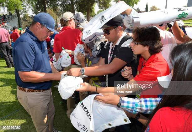 Jason Dufner signs autographs for fans during practice for the World Golf ChampionshipsMexico Championship at Club de Golf Chapultepec on February 28...