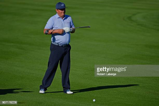 Jason Dufner stretches on the 12th hole during the second round of the CareerBuilder Challenge at the Jack Nicklaus Tournament Course at PGA West on...