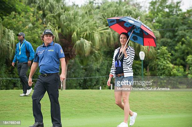 Jason Dufner walks with wife Amanda during the Final Round of the 31st PGA Grand Slam of Golf at Port Royal Golf Course on October 16 2013 in...