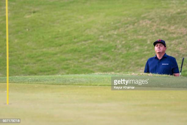 Jason Dufner watches his shot onto the first hole green during a playoff with Louis Oosthuizen of South Africa in round three of the World Golf...