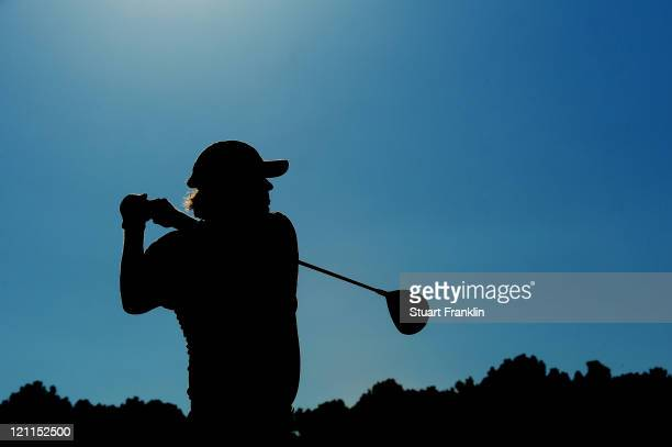 Jason Dufner watches his tee shot on the 18th hole during the final round of the 93rd PGA Championship at the Atlanta Athletic Club on August 14,...