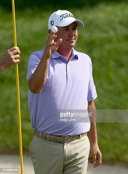 Jason Dufner waves to the gallery after making a hole in one on the 16th hole during the second round of The Memorial Tournament presented by...