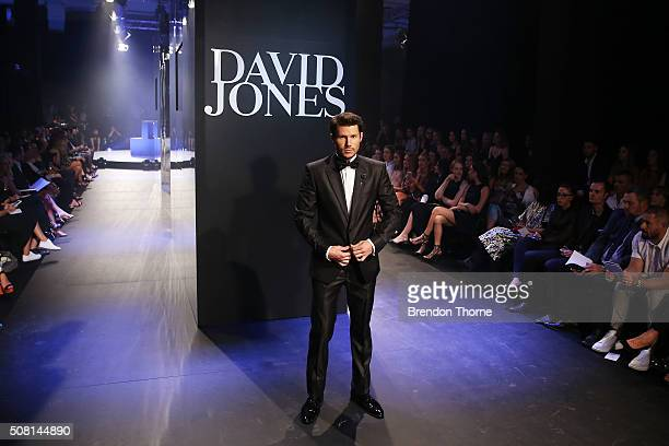 Jason Dundas showcases designs by Versace on the runway at the David Jones Autumn/Winter 2016 Fashion Launch at David Jones Elizabeth Street Store on...