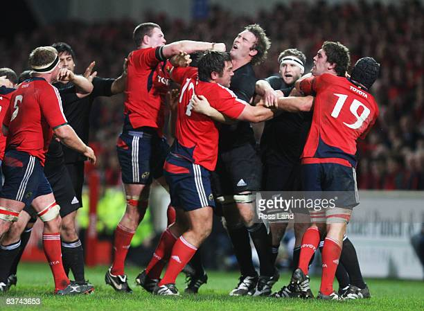 Jason Eaton of the All Blacks is punched in the mouth by Donnacha Ryan of Munster during the Munster V New Zealand All Blacks rugby match at Thomond...