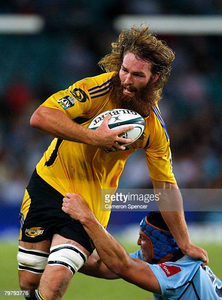 Jason Eaton of the Hurricanes is tackled during the round one Super 14 match between the New South Wales Waratahs and the Hurricanes at Sydney...