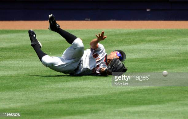 Jason Ellison of the San Francisco Giants makes an unsuccessful diving attempt for a fly ball during 54 loss to the Los Angeles Dodgers at Dodger...