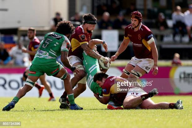 Jason Emery of Manawatu is tackled by Elliot Dixon and Shaun Stodart of Southland during the round seven Mitre 10 Cup match between Southland and...