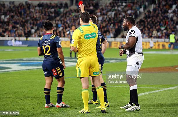 Jason Emery of the Highlanders receives a red card for a dangerous tackle from referee Ben O'Keefe during the round nine Super Rugby match between...