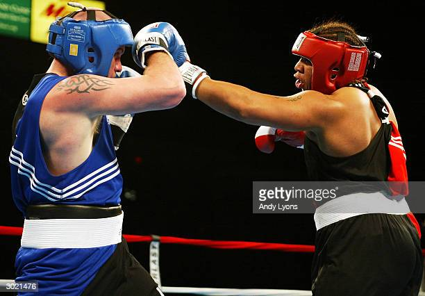 Jason Estrada of Providence Rhode Island lands a punch during his super heavyweight match against Mike Wilson of Central Point Oregon during the 2004...
