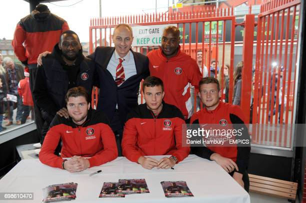 Jason Euell and Richard Rufus with Charlton under 21 players signing autographs in the club shop