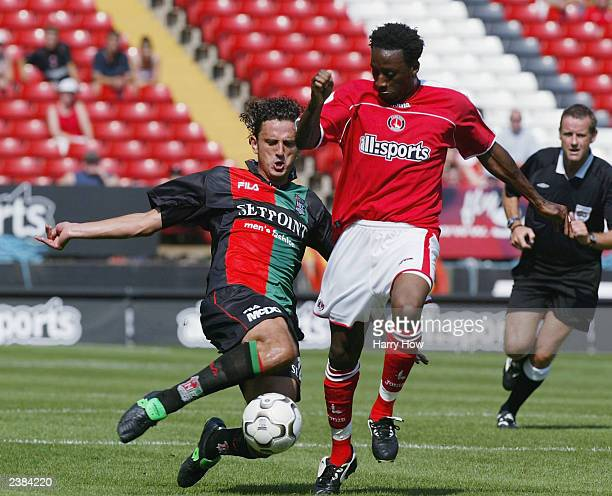 Jason Euell of Charlton attempts to elude the check of Dejan Govedarica of NECNijmegen during the preseason friendly match between Charlton Athletic...
