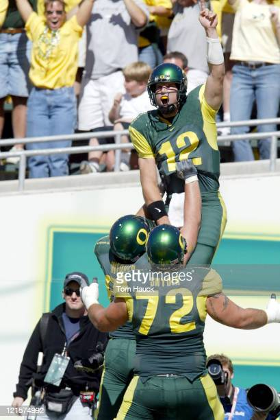Jason Fife of the Oregon Ducks celebrates his touchdown with teammates against the Michigan Wolverines at Autzen Stadium in Eugene Oregon Oregon...