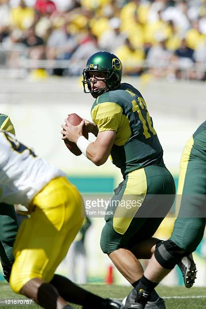 Jason Fife of the Oregon Ducks drops back to throw a pass against the Michigan Wolverines at Autzen Stadium in Eugene Oregon Oregon defeated Michigan...