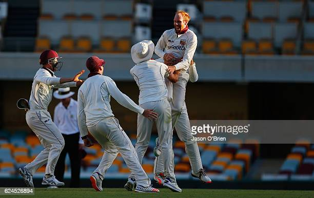 Jason Floros of the Bulls celebrates taking the final wicket of Chadd Sayers during day four of the Sheffield Shield match between Queensland and...