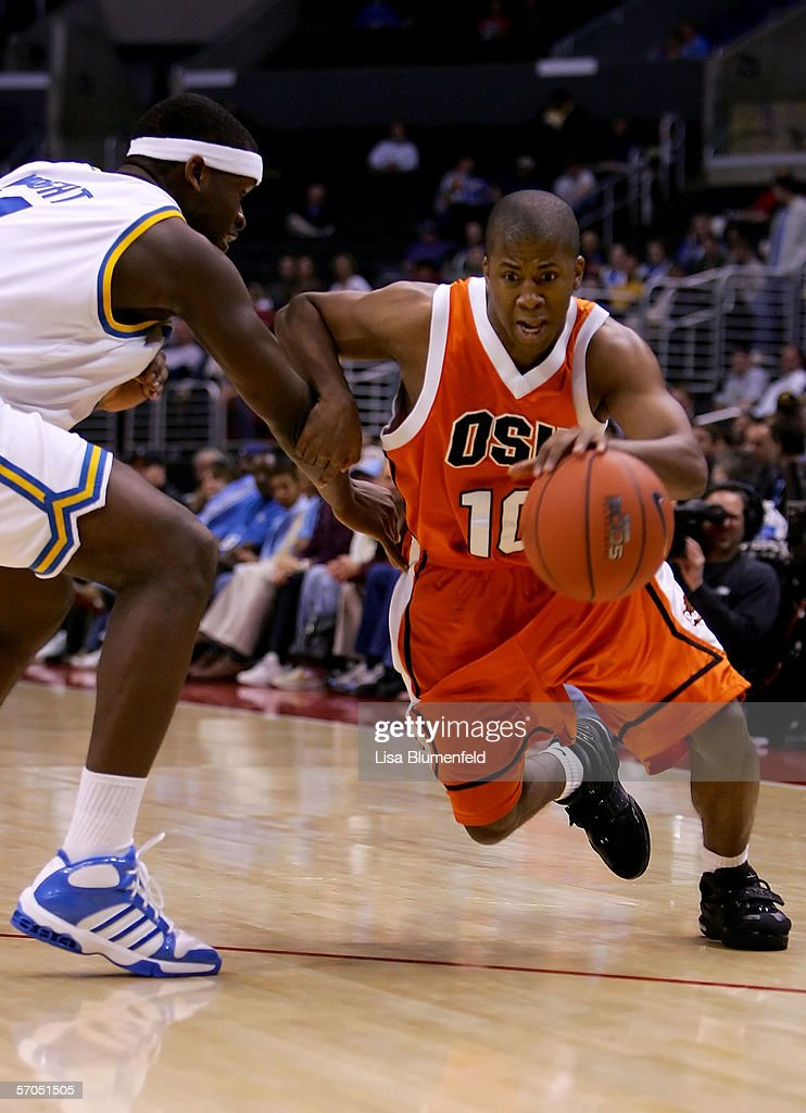 Jason Fontenet #10 of the Oregon State Beavers drives the ball around Ryan Wright #11 of the UCLA Bruins during the quarterfinals of the 2006 Pacific Life Pac-10 Men's Basketball Tournament on March 9, 2006 at Staples Center in Los Angeles, California.