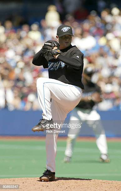 Jason Frasor of the Toronto Blue Jays pitches against the Boston Red Sox during the game on May 16 2004 at Skydome in Toronto Ontario Canada The Blue...