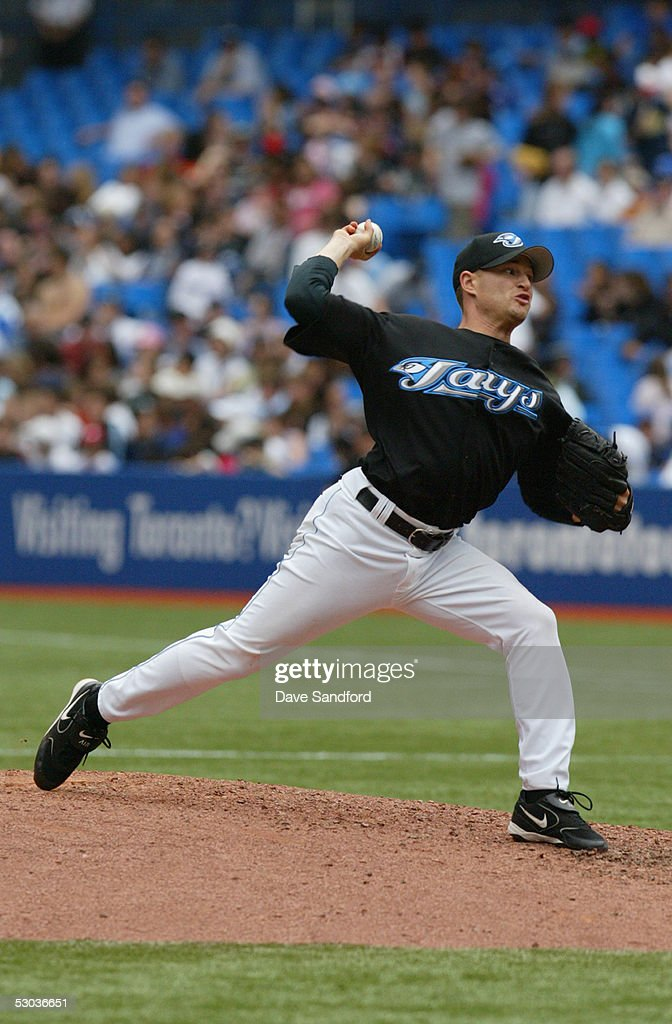 Jason Frasor #54 of the Toronto Blue Jays pitches against the Kansas City Royals during the game at Rogers Centre on May 11, 2005 in Toronto, Ontario. The Blue Jays defeated the Royals 12-9.