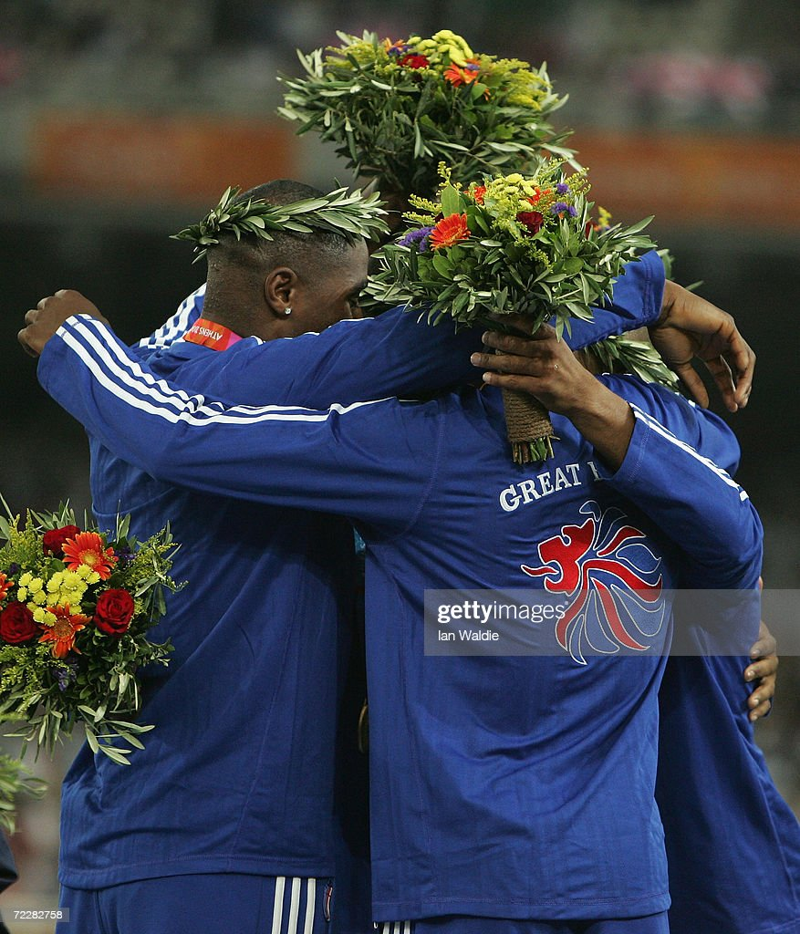 Jason Gardener, Darren Campbell, Marlon Devonish and Mark Lewis-Francis of the Great Britain relay team receives the medal during the men's 4 x 100 metre relay medal ceremony on August 28, 2004 during the Athens 2004 Summer Olympic Games at the Olympic Stadium in the Sports Complex in Athens, Greece.