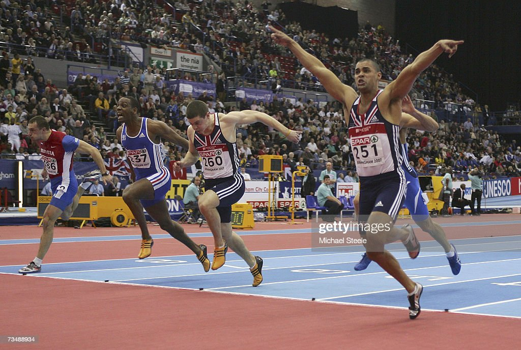 Jason Gardener of Great Britain (251) celebrates he crosses the line to win gold ahead Craig Pickering of Great Britain (260) during the Men's 60 Metres Final on day three of the 29th European Athletics Indoor Championships at the National Indoor Arena on March 4, 2007 in Birmingham, England.