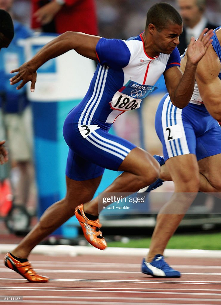 Jason Gardener of Great Britain powers out of the blocks in the men's 100 metre event on August 21, 2004 during the Athens 2004 Summer Olympic Games at the Olympic Stadium in the Sports Complex in Athens, Greece.