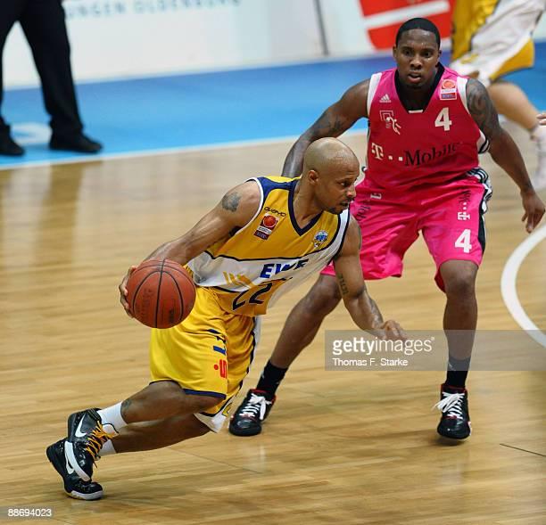 Jason Gardner of Oldenburg and EJ Rowland of Bonn in action during the Basketball Bundesliga PlayOff match between EWE Baskets Oldenburg and Telekom...