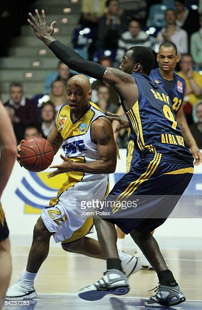 Jason Gardner of Oldenburg challenges Ansu Sesay of Berlin during the Basketball Bundesliga match between EWE Baskets Oldenburg and ALBA Berlin at...