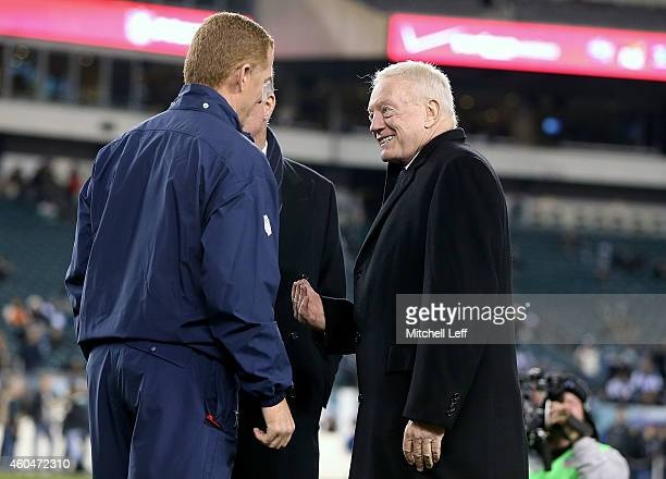 Jason Garrett head coach of the Dallas Cowboys talks with owner Jerry Jones prior to the game against the Philadelphia Eagles at Lincoln Financial...