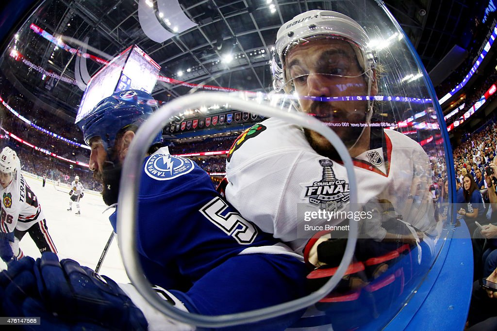 Jason Garrison #5 of the Tampa Bay Lightning checks Antoine Vermette #80 of the Chicago Blackhawks during the first period during Game Two of the 2015 NHL Stanley Cup Final at Amalie Arena on June 6, 2015 in Tampa, Florida.