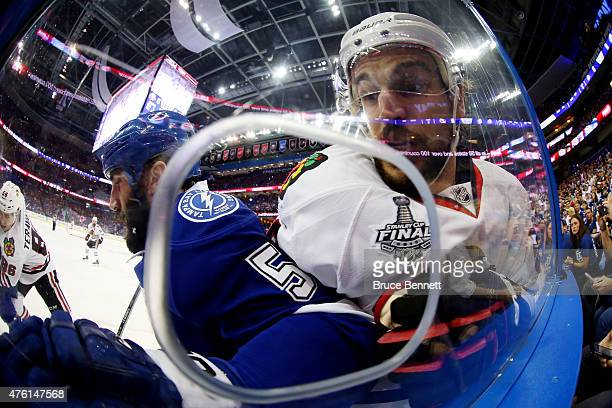 Jason Garrison of the Tampa Bay Lightning checks Antoine Vermette of the Chicago Blackhawks during the first period during Game Two of the 2015 NHL...