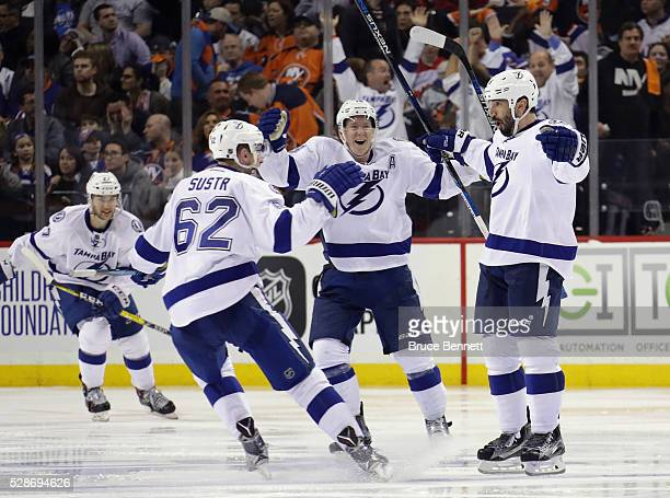 Jason Garrison of the Tampa Bay Lightning scores at 134 of overtime to defeat the New York Islanders 21 in Game Four of the Eastern Conference Second...
