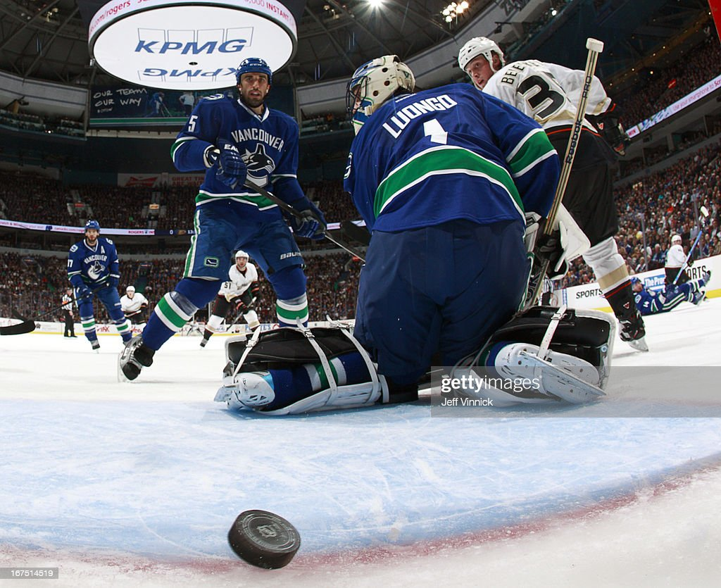 Jason Garrison #5 of the Vancouver Canucks and goal scorer Matt Beleskey #39 of the Anaheim Ducks watch the puck slip behind Roberto Luongo #1 of the Canucks during their NHL game at Rogers Arena April 25, 2013 in Vancouver, British Columbia, Canada.