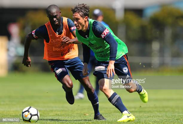 Jason Geria and Mark Milligan of the Victory compete for the ball during a Melbourne Victory ALeague training session at Gosch's Paddock on October...