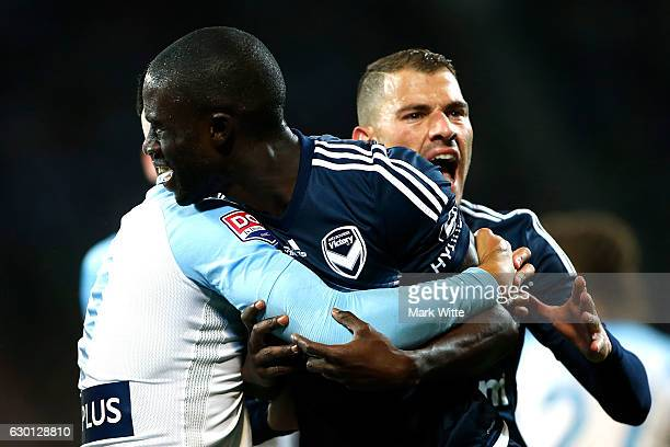 Jason Geria of Melbourne Victory gets held back by Tim Cahill of Melbourne Victory after an altercation during the round 11 ALeague match between...