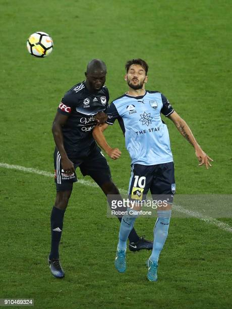 Jason Geria of the Victory and Milos Ninkovic of Sydney FC compete for the ball during the round 18 ALeague match between Melbourne Victory and...
