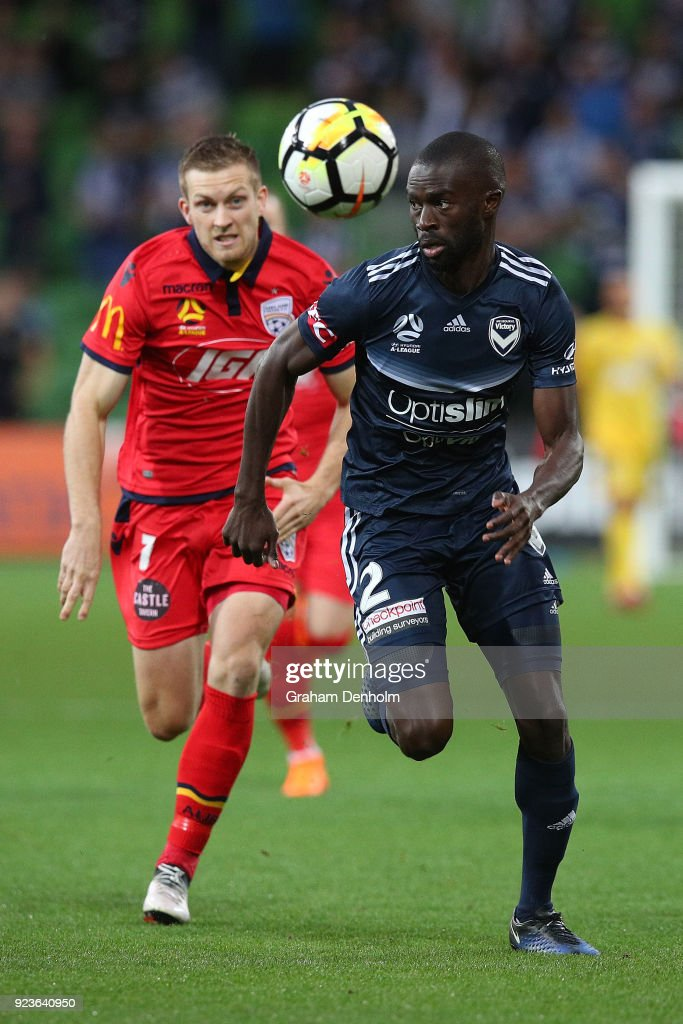 Jason Geria of the Victory (R) and Ryan Kitto of United chase the ball during the round 21 A-League match between the Melbourne Victory and Adelaide United at AAMI Park on February 24, 2018 in Melbourne, Australia.