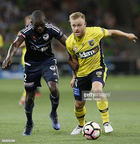Jason Geria of the Victory battles with his former team mate Connor Pain of Central Coast Mariners during the round 12 ALeague match between...