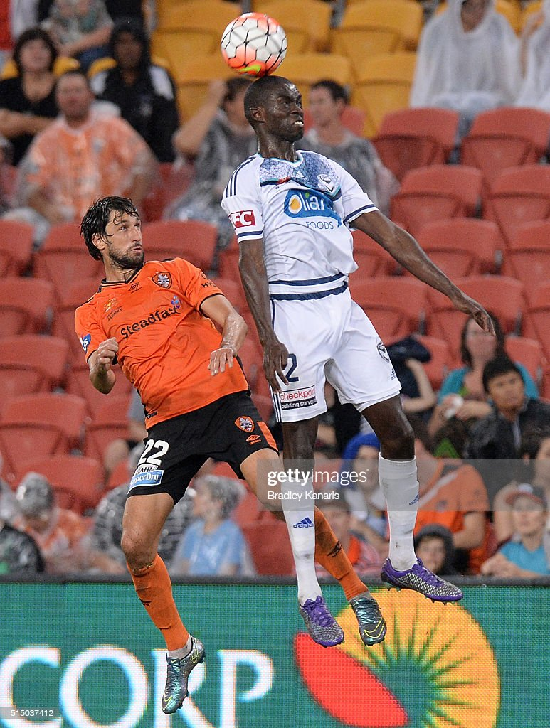 Jason Geria of the Victory gets above Thomas Broich of the Roar during the round 23 A-League match between the Brisbane Roar and Melbourne Victory at Suncorp Stadium on March 12, 2016 in Brisbane, Australia.