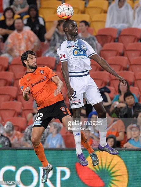 Jason Geria of the Victory gets above Thomas Broich of the Roar during the round 23 ALeague match between the Brisbane Roar and Melbourne Victory at...