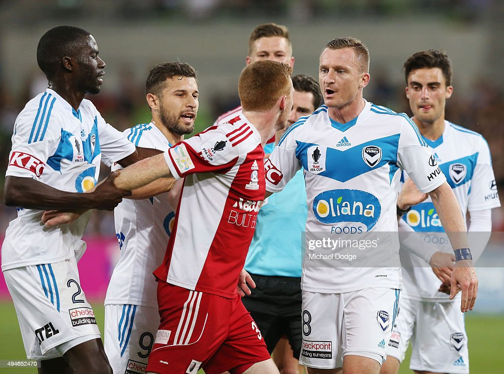 Jason Geria of the Victory holds back Nick Hegarty of the City who is confronted by Besart Berisha of the Victory (R) after a contest during the FFA Cup Semi Final match between Hume City and Melbourne Victory at AAMI Park on October 28, 2015 in Melbourne, Australia.