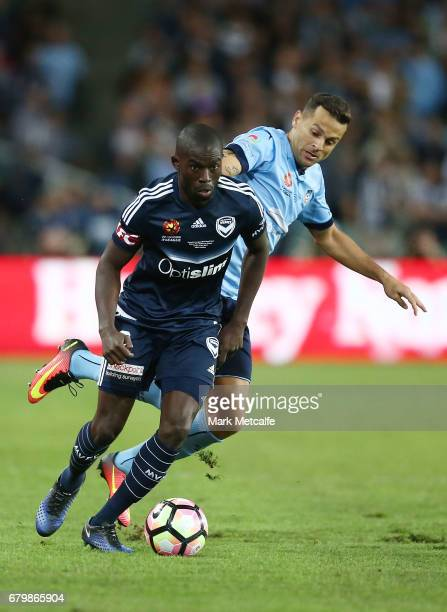 Jason Geria of the Victory is challenged by Bobo of Sydney FC during the 2017 ALeague Grand Final match between Sydney FC and the Melbourne Victory...