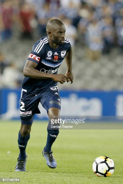 Jason Geria of the Victory runs with the ball during the round six ALeague match between the Melbourne Victory and Brisbane Roar at Etihad Stadium on...